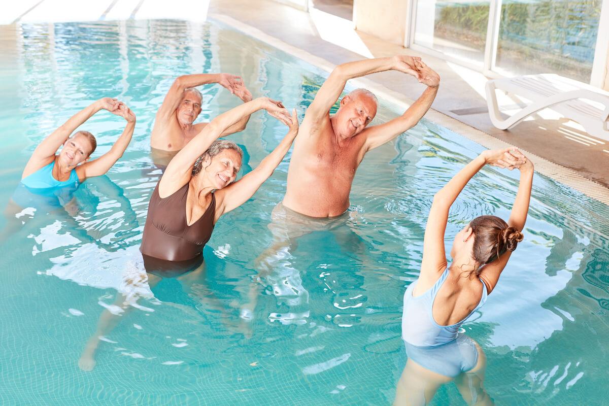 People doing stretches for aquatic therapy session