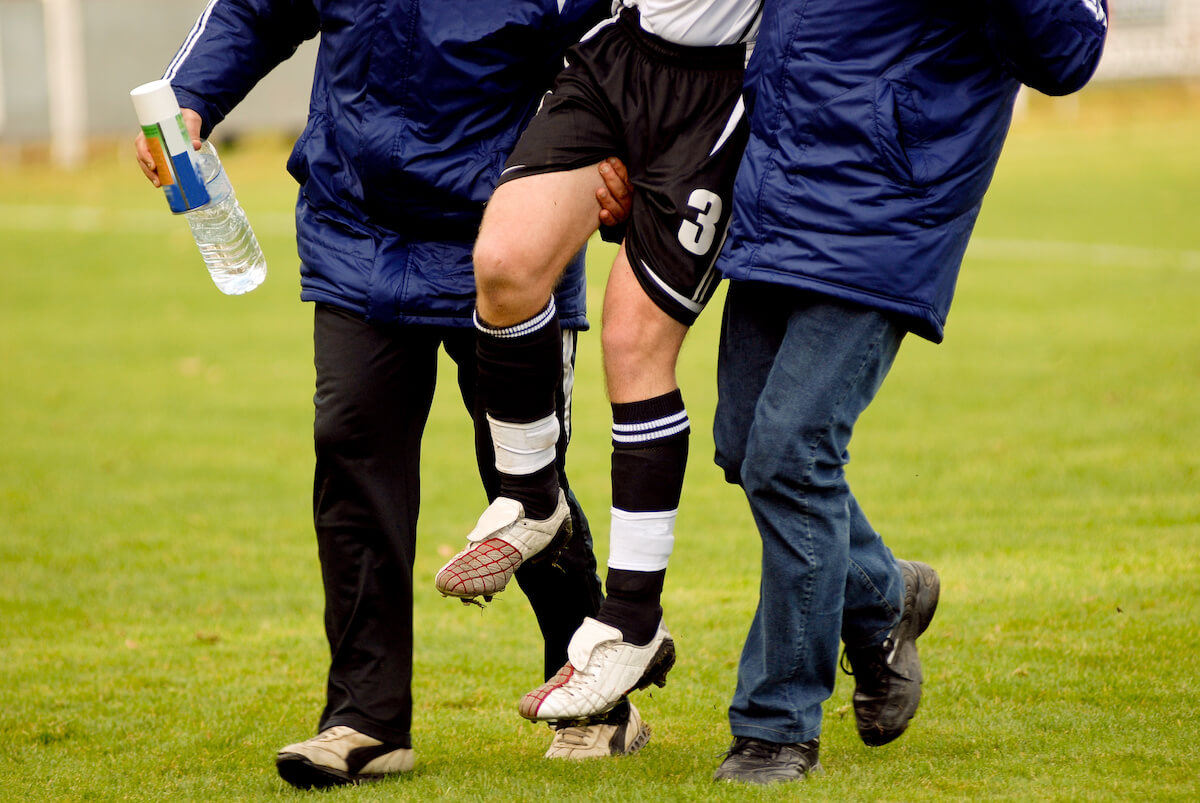 Soccer player gets injured and carried off soccer field